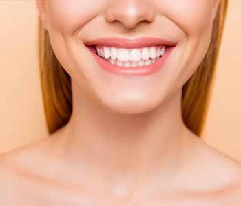 Lady is showing her brighter teeth