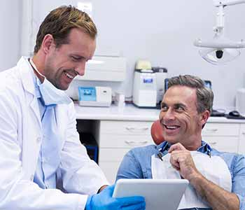 Mouth Carolina Dentistry Charleston dentist speaks to patients about dental crowns