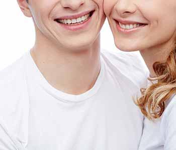 Charleston Dentist Porcelain Dental Veneers - happ couple is showing their brighter teeth