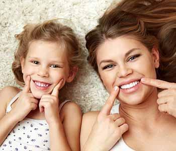 Charleston Dentist Veneers - momy and daughter are showing their brighter teeth