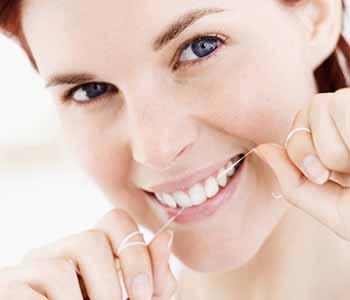 Dental Veneers on front teeth - Lady is claening her teeth herself