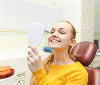 "Mouth Carolina Dentistry Charleston SC area dentist calms anxiety with answer to, ""Does veneers treatment hurt?"""