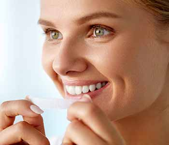 Dentist Near Ashley Offers Professional-Grade Teeth Whitening Solutions That Can Be Done At Home