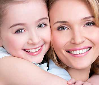 Porcelain Veneers in West Ashley - Mother and daughter are smilling with showing their brighter teeth