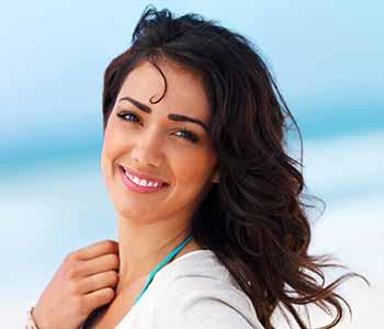 Veneers on Teeth Dentist West Ashley - lady is showing her teeth with a nice smile