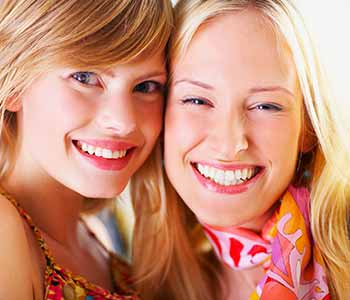 West Ashley Dentist Cosmetic Veneers - girls are showing there brighter teeth with a nice smile